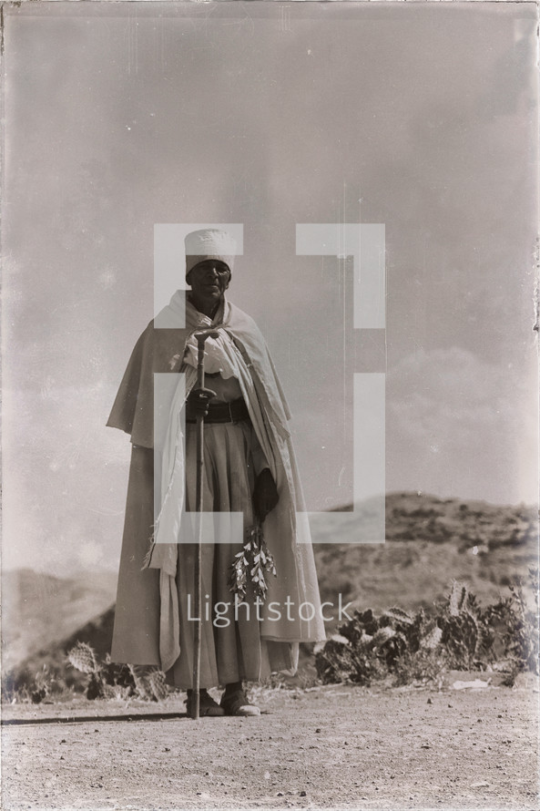 mountain priest walking in Africa