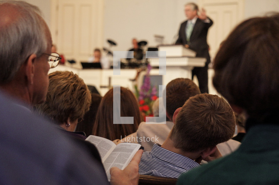 minister preaching an attentive parishioners