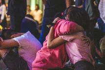 hugs at a worship service
