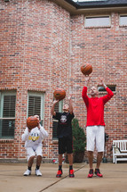 father and son's playing basketball