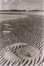ripples in sand on a beach