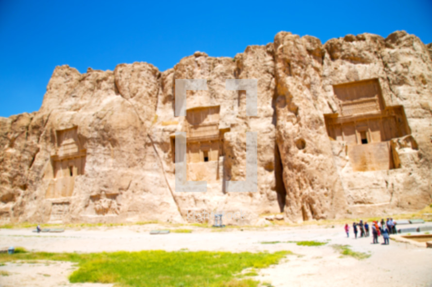 ruins of buildings built into cliffs in Iran