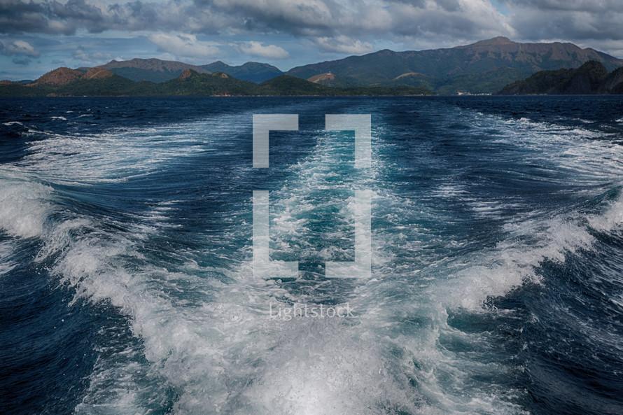 boat trails in ocean water