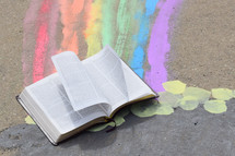 Bible in a pot of gold at the end of a rainbow