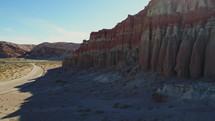 road through red rock cliffs