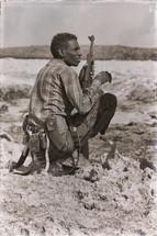 a soldier in Africa holding a gun