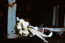 bride bouquet in the corner of a rusty window sill
