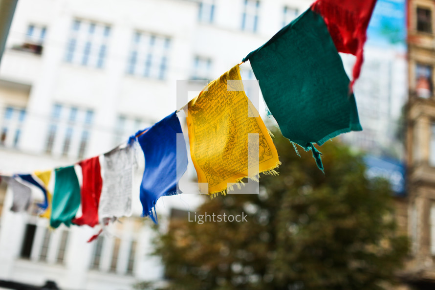 Colorful flags hanging from buildings