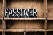 word passover in blocks on a bookshelf