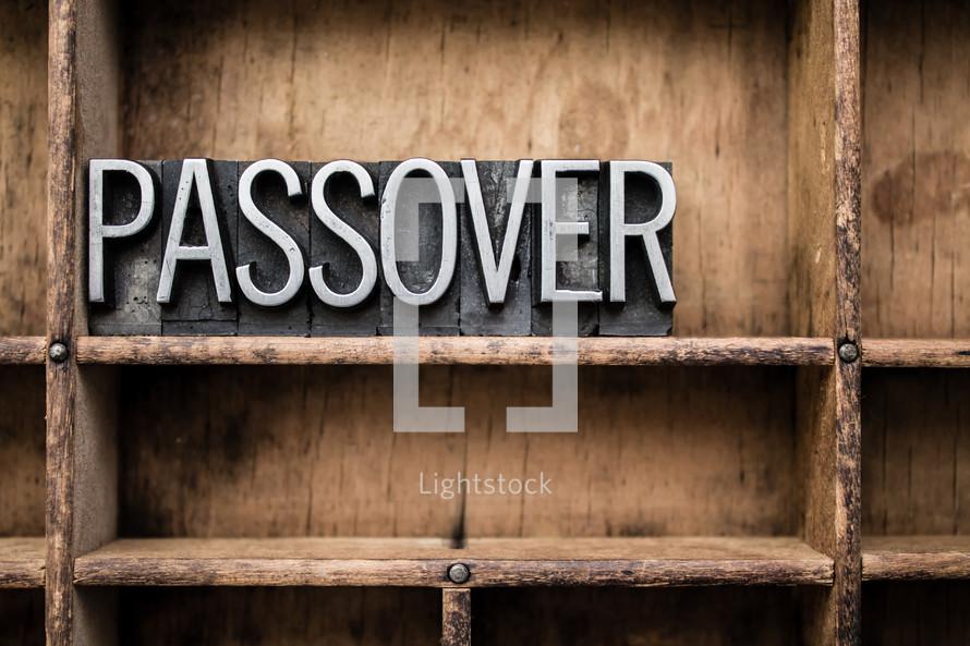 word passover in blocks on a bookshelf