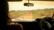 driving down a dirt road in Uganda