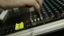 hands on a soundboard