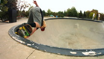skateboarder doing tricks at a skate park