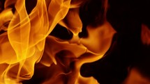 slow motion of a close up of flames from a fire.