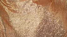 flowing glittery gold fabric background