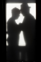 shadow of an elderly couple