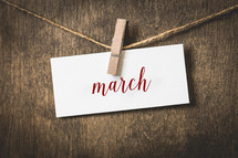 word March hanging on a clothesline