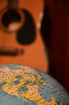 guitar and world globe