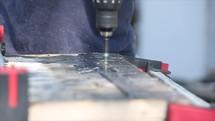 man using a screwdriver