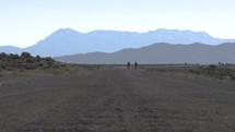 biking down a dirt road
