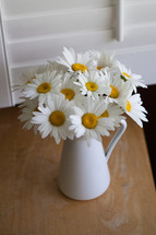 white daisies in a pitcher