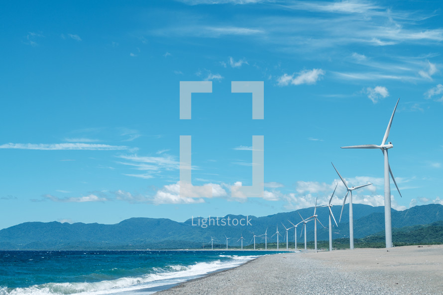 wind turbines along a shore