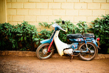A motorbike on a kickstand