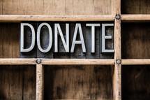 word donate on a bookshelf