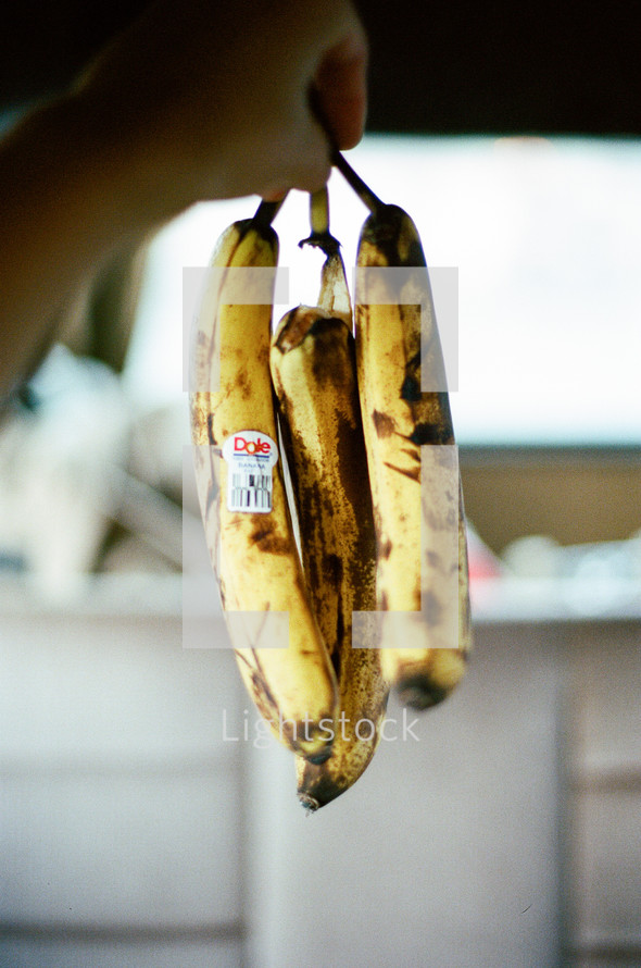 throwing out rotten bananas