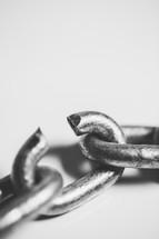 A broken link in a chain.