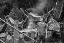 a man standing in a market in Toraja