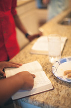 finger pointing to a Bible verse at a Bible study