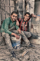 two young men brick layers