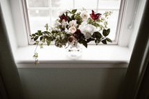 flower arrangement in a window sill