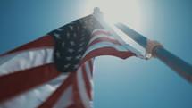 American flag against a blue sky