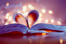 Pages of a Bible folded into the shape of a heart.