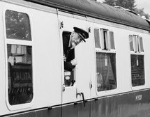 a conductor looking out of a train window