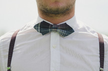 man in a bow tie and suspenders