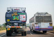 truck and bus on a highway in India