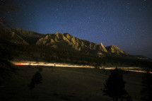 Long Exposure of the Flat Irons, Boulder Colorado as a car passes under the mountains.