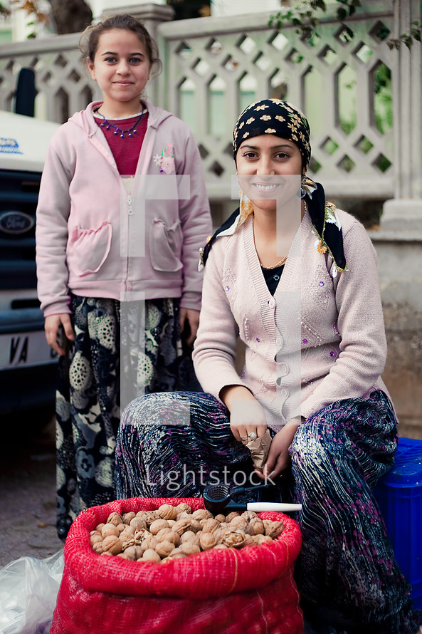 Mother and daughter selling walnuts