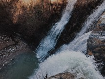 looking down at a waterfall from overhead