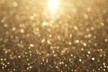 gold bokeh sparkle background