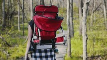 a baby hiking with mom