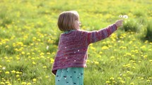 girl child picking flowers outdoors