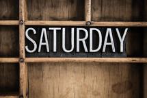 word Saturday in blocks on a bookshelf