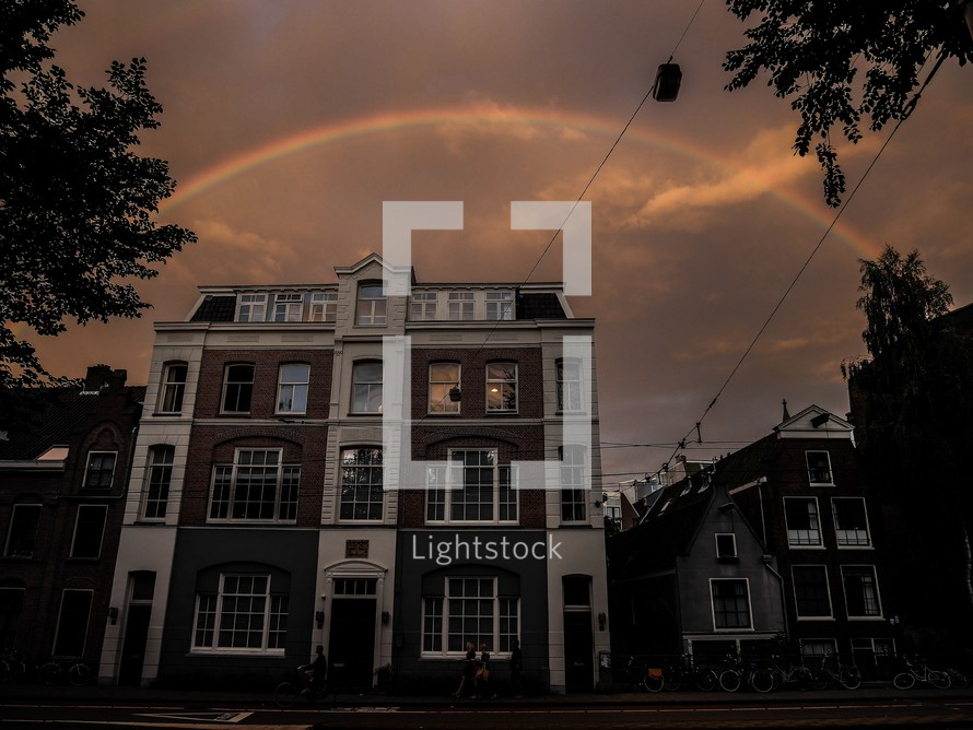 rainbow over a brick building in Amsterdam, Netherlands