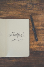 word steadfast on paper