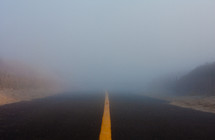 A highway leading into fog.