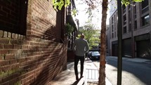 man walking down a sidewalk